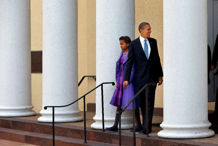 President Barack Obama and daughter Sasha leaves St. John's Church in Washington, Monday, Jan. 21, 2013, after attending a church service during the 57th Presidential Inauguration. Photo: Jacquelyn Martin, Associated Press / AP