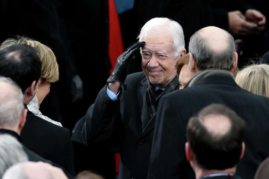 Former U.S. President Jimmy Carter gestures during the presidential inauguration on the West Front o