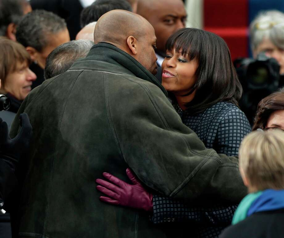 First lady Michelle Obama  is greeted by her brother Craig Robinson at the ceremonial swearing-in for President Barack Obama at the U.S. Capitol during the 57th Presidential Inauguration in Washington, Monday, Jan. 21, 2013. Photo: Pablo Martinez Monsivais, Associated Press / AP