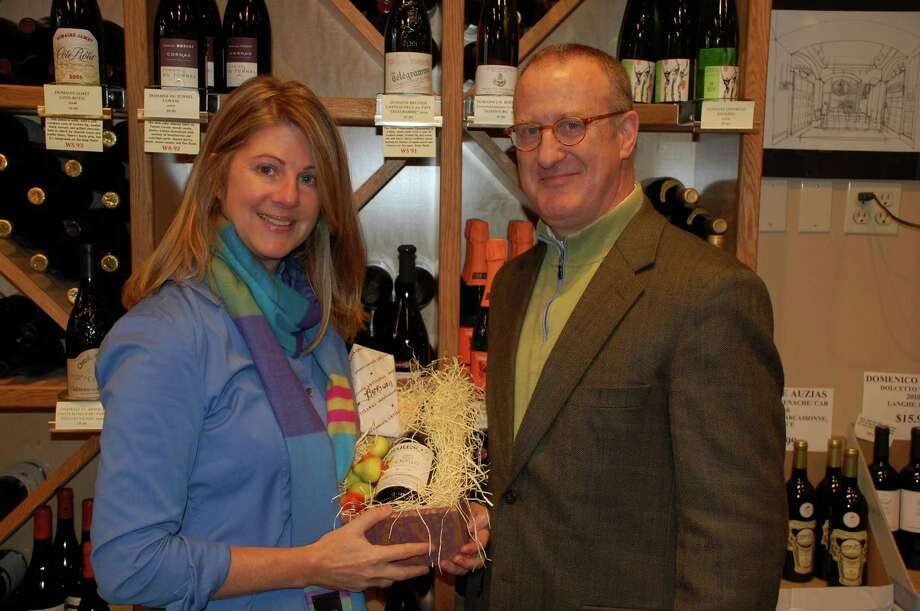 Jarret Liotta/For the New Canaan News Erin Hedley, owner of La Dame du Fromage, and Jeff Barbour, owner of New Canaan Wine Merchants, are starting the Wine and Cheese Society of New Canaan. Experts in their respective fields, the two hope to spread the joy of this age-old culinary combination, and make some money for the New Canaan Food Pantry in the process. Photo: Contributed