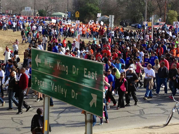 Participants gather at MLK Boulevard and the Interstate 10 overpass for the Martin Luther King Jr. March on Monday morning. Photo: Bob Owen/ San Antonio Express-Ne / Bob Owen/ San Antonio Express-Ne
