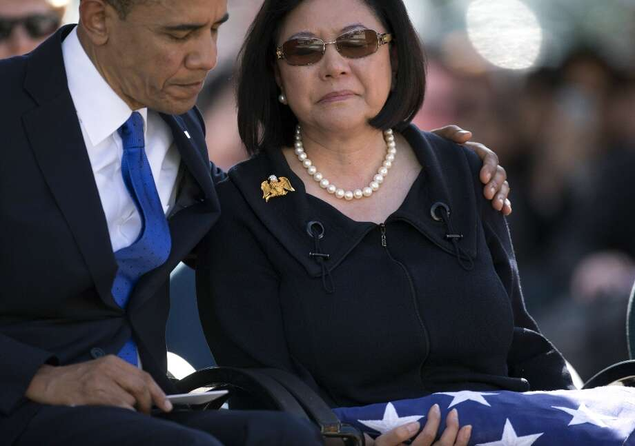 President Barack Obama comforts Irene Hirano Inouye, the widow of the late Sen. Daniel Inouye, at the National Memorial Cemetery of the Pacific, Sunday, Dec. 23, 2012, in Honolulu. Inouye was the first Japanese-American elected to both houses of Congress and the second-longest serving senator in U.S. history. Photo: Carolyn Kaster, Associated Press / AP