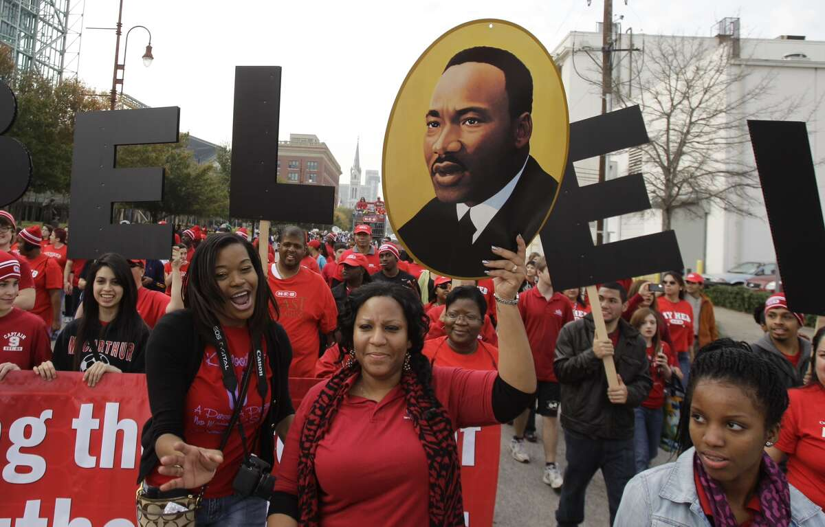 People participating in the Black Heritage Society MLK Parade Monday, Jan. 21, 2013 in Houston.