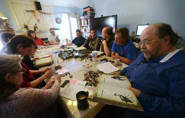 Greg Geilman, right, joins others in a game of Dungeons and Dragons on Saturday, Jan. 19, 2013. Photo: Billy Calzada, San Antonio Express-News / SAN ANTONIO EXPRESS-NEWS