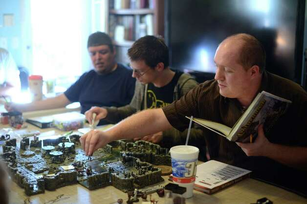 Carlos Garza, left, Travis Mussells and James Kohlwes play Dungeons and Dragons on Saturday, Jan. 19, 2013. Photo: Billy Calzada, San Antonio Express-News / SAN ANTONIO EXPRESS-NEWS
