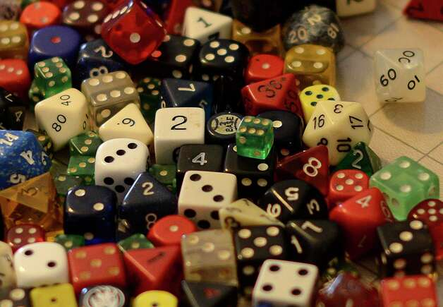 Many dice are used in the game of Dungeons and Dragons. Saturday, Jan. 19, 2013. Photo: Billy Calzada, San Antonio Express-News / SAN ANTONIO EXPRESS-NEWS