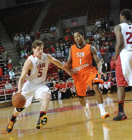 Lamar Cardinal #5, Hondo Webb, left, brings the ball downcourt as Sam Houston Bearkat #1, Darius Gatson, right, tries to block him. The Lamar men's and women's basketball teams played Sam Houston State in a doubleheader Thursday night, January 10, 2013. The men's team was trying to get back on track after losing both games on the road last week.  Dave Ryan/The Enterprise Photo: Dave Ryan