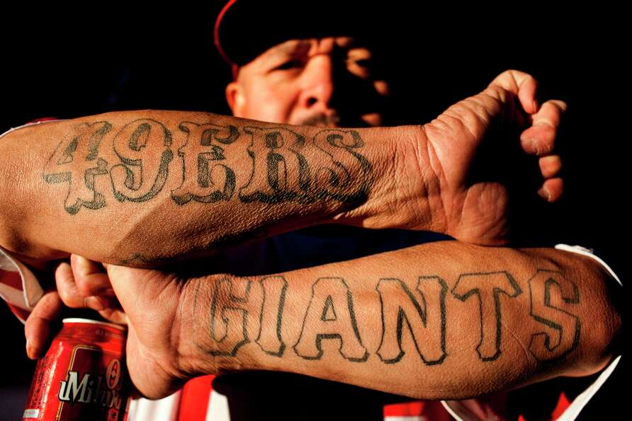 Joey Moreno showed off his 49ers and Giants tattoos during celebrations along 24th Street after the