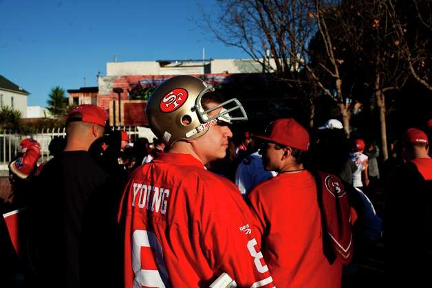 Niners fans celebrated at 24th and Mission Streets after the San Francisco 49er's beat the Atlanta Falcons in San Francisco, Calif., Sunday, January, 20, 2013. Photo: Jason Henry, Special To The Chronicle / ONLINE_YES