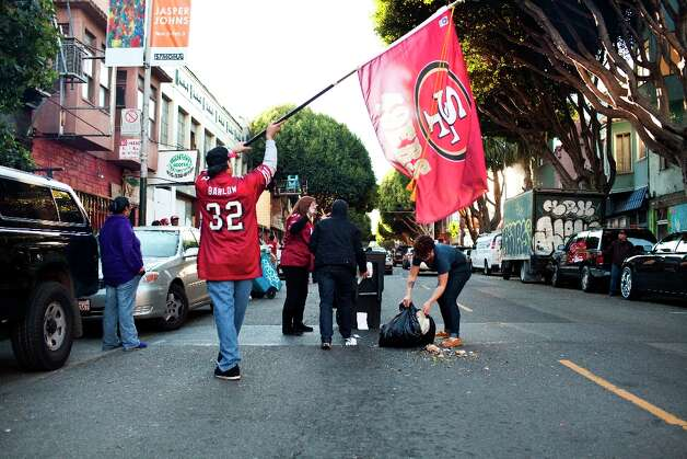 A Niners fan pushed a trash can onto 24th Street and was promptly arrested by SFPD during celebrations and residents helped clean it up after the San Francisco 49er's beat the Atlanta Falcons in San Francisco, Calif., Sunday, January, 20, 2013. Photo: Jason Henry, Special To The Chronicle / ONLINE_YES