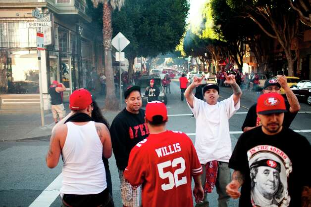 Niner's fans celebrated along 24th Street after the San Francisco 49er's beat the Atlanta Falcons in San Francisco, Calif., Sunday, January, 20, 2013. Photo: Jason Henry, Special To The Chronicle / ONLINE_YES