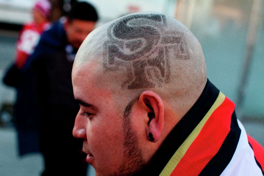 Francisco Duartez shaved the 49ers logo onto the side of his head as he celebrated along 24th Street