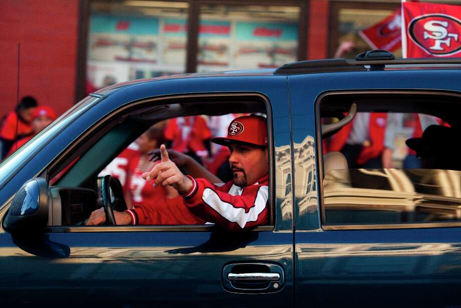 Niners fans honked their horns along Mission Street after the San Francisco 49er's beat the Atlanta Falcons in San Francisco, Calif., Sunday, January, 20, 2013. Photo: Jason Henry, Special To The Chronicle / ONLINE_YES