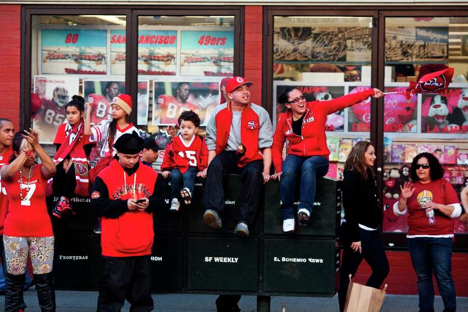 Niners fans celebrated along Mission Street after the San Francisco 49er's beat the Atlanta Falcons in San Francisco, Calif., Sunday, January, 20, 2013. Photo: Jason Henry, Special To The Chronicle / ONLINE_YES