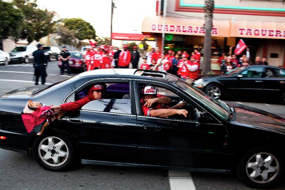 Fans honked their horns and hung out the windows of cars during celebrations along 24th Street after the San Francisco 49er's beat the Atlanta Falcons in San Francisco, Calif., Sunday, January, 20, 2013. Photo: Jason Henry, Special To The Chronicle / ONLINE_YES
