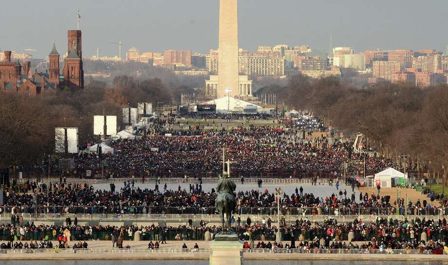 Spectators gather in the early morning light on the National Mall, waiting for President Barack Obama to be sworn-in for a second term as the President of the United States, Monday, January 21, 2013 in Washington, D.C. Photo: Pat Benic/UPI, McClatchy-Tribune News Service / MCT