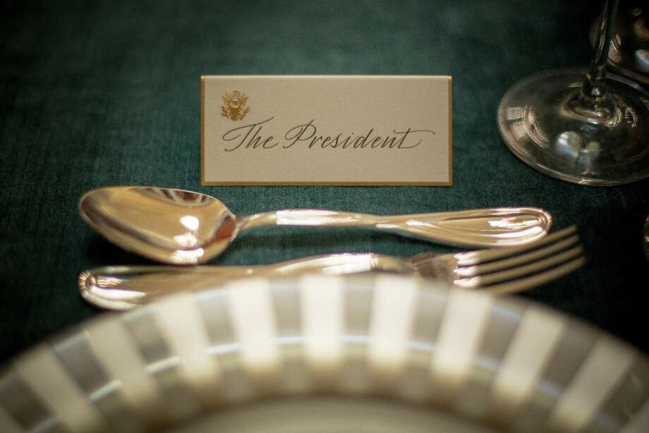 The place card for U.S. President Barack Obama sits ready for the Inaugural Luncheon in Statuary Hall on inauguration day at the U.S. Capitol building January 21, 2013 in Washington D.C. U.S. President Barack Obama, will be ceremonially sworn in for his second term today. Photo: Allison Shelley, Getty Images / 2012 Getty Images