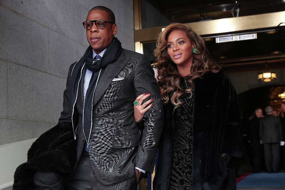 Recording artists Jay-Z and Beyonce arrive at the presidential inauguration on the West Front of the U.S. Capitol January 21, 2013 in Washington, DC.   Barack Obama was re-elected for a second term as President of the United States. Photo: Win McNamee/Getty Images, McClatchy-Tribune News Service / MCT