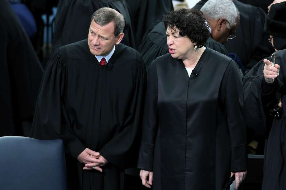 Supreme Court Chief Justice John Roberts and Supreme Court Justice Sonia Sotomayor attend the presidential inauguration on the West Front of the U.S. Capitol January 21, 2013 in Washington, DC.   Barack Obama was re-elected for a second term as President of the United States. Photo: John Moore, Getty Images / 2013 Getty Images