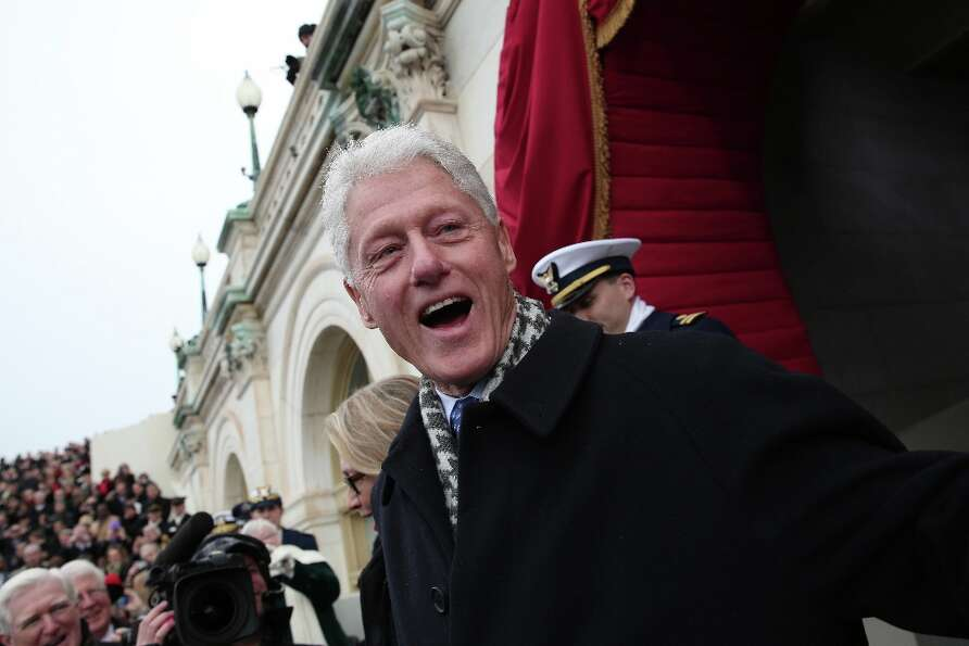 Former US President Bill Clinton arrives during the presidential inauguration on the West Front of t
