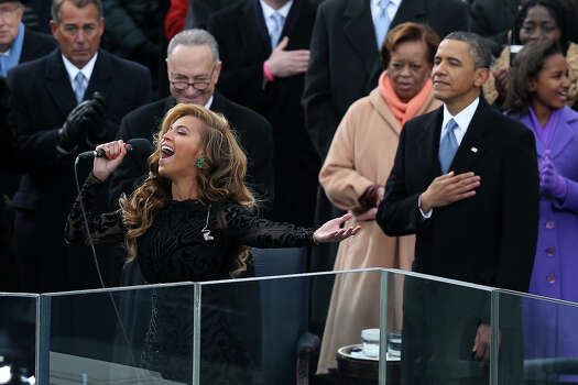 WASHINGTON, DC - JANUARY 21:  Beyonc? performs the national anthem as U.S. President Barack Obama looks on during the presidential inauguration on the West Front of the U.S. Capitol January 21, 2013 in Washington, DC.   Barack Obama was re-elected for a second term as President of the United States. Photo: Alex Wong, Getty Images / 2013 Getty Images