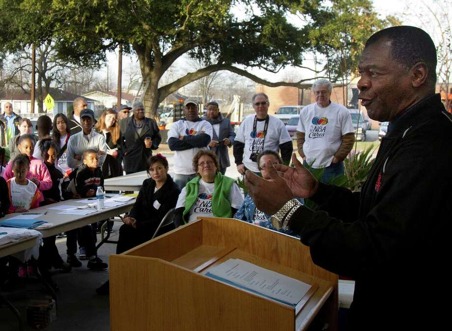 Former Houston Rocket Calvin Murphy addresses the crowd before helping plant trees at M. E. Foster Elementary School, Monday, Jan. 21, 2013, in Houston. Rebuilding Together Houston and NBA Cares partnered to help revitalize the Foster Place community as part of the 2013 Martin Luther King, Jr. Day of Service. The event included community cleanup, landscaping, and tree planting at Foster Place Elementary School and throughout the neighborhood. Photo: Cody Duty, Houston Chronicle / © 2012 Houston Chronicle