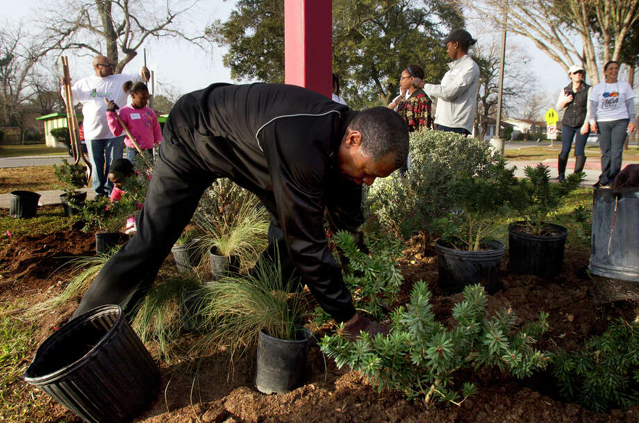 Former Houston Rocket Calvin Murphy plants a tree at M. E. Foster Elementary School, Monday, Jan. 21, 2013, in Houston. Rebuilding Together Houston and NBA Cares partnered to help revitalize the Foster Place community as part of the 2013 Martin Luther King, Jr. Day of Service. The event included community cleanup, landscaping, and tree planting at Foster Place Elementary School and throughout the neighborhood. Photo: Cody Duty, Houston Chronicle / © 2012 Houston Chronicle