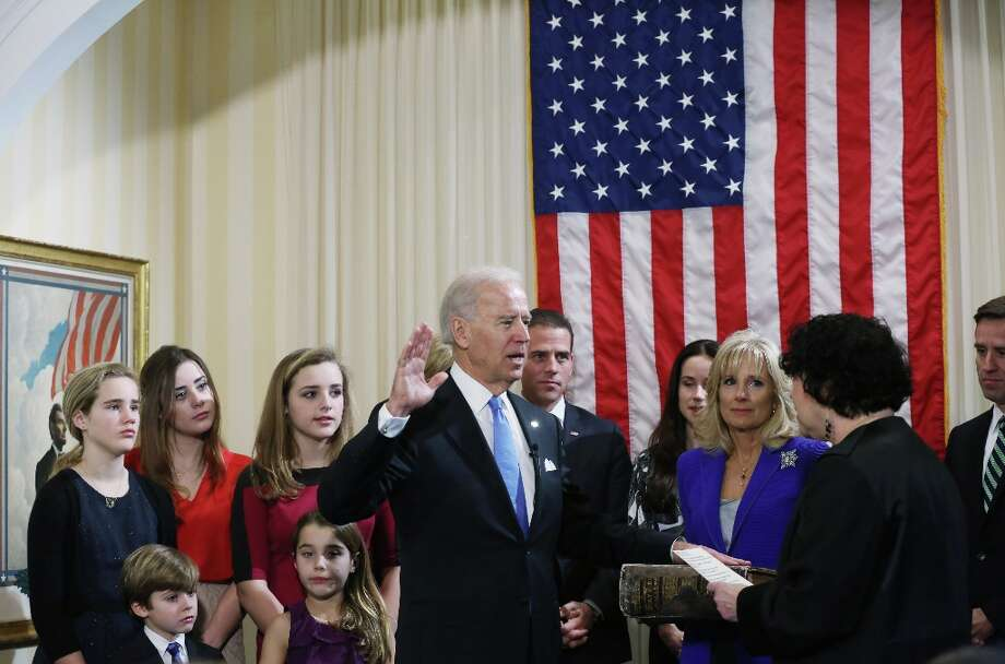 U.S. Vice President Joe Biden (C) takes the oath of office from U.S. Supreme Court Justice Sonia Sotomayor (2nd R) as his wife Dr. Jill Biden (3rd R) looks on during the official swearing-in ceremony at the Naval Observatory on January 20, 2013 in Washington, DC. Biden and U.S. President Barack Obama will be officially sworn in a day before the ceremonial inaugural swearing-in. Photo: Pool, Getty Images / 2013 Getty Images