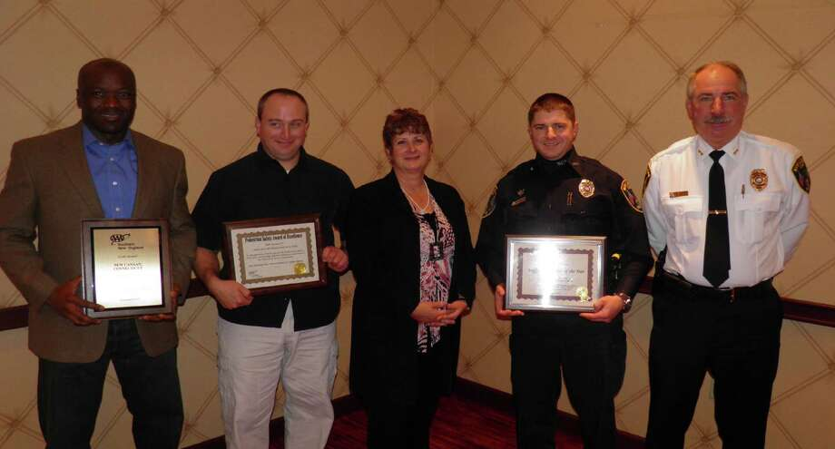 AAA Southern New England-CT recently honored the New Canaan Police Department with a Gold Award for the departmentís outstanding traffic safety programs. In the third annual AAA Community Traffic Safety Award lunch at the Trumbull Marriott, Public Affairs Manager Fran Mayko, center, presented department members with a variety of awards including a Gold Award that recognized the departmentís various traffic safety programs. From left, Officer Rex Sprosta, with the Gold Award and Officer Dan Gulino, with an award recognizing the town for not having a pedestrian traffic fatality for one year. Both officers are AAAís certified Driving Improvement Program instructors. Second from right, Officer Marc DeFelice, the townís traffic enforcement officer, was nominated by Chief Edward Nadriczny, far right, as a AAA Traffic Safety Hero. He was recognized for his work with the townís Student Guardian School Bus violation program, its Citizens Police Academy and school bus safety. Photo: Contributed Photo