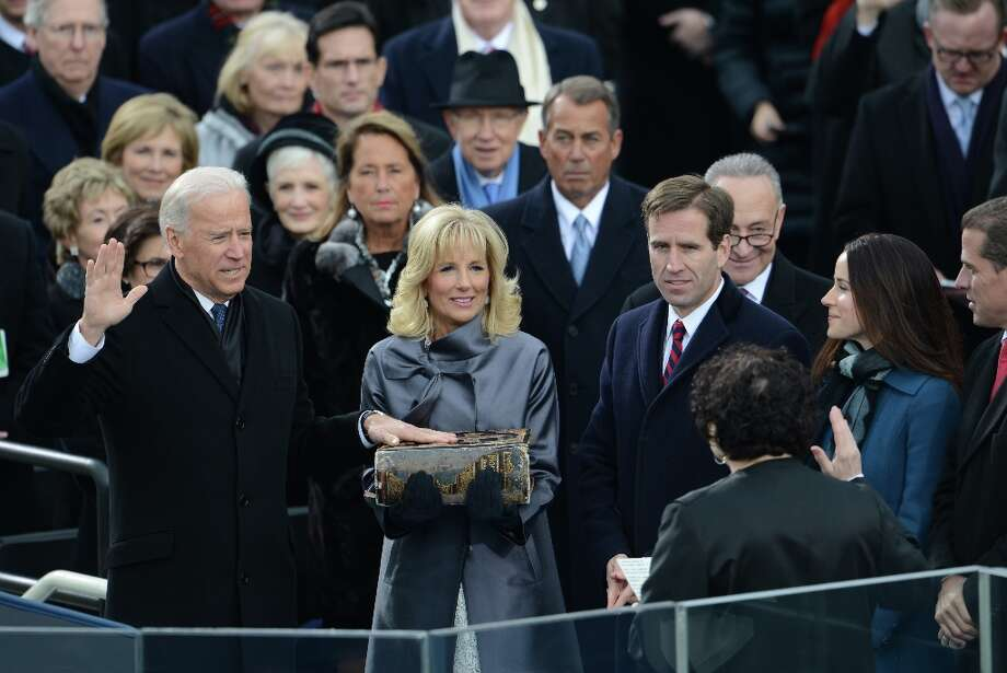 U.S. Vice President Joe Biden(L) is sworn-in as his wifeJill(C) holds the Bible during the 57th Presidential Inauguration ceremonial swearing-in at the US Capitol on January 21, 2013 in Washington, DC. Photo: STAN HONDA, AFP/Getty Images / AFP