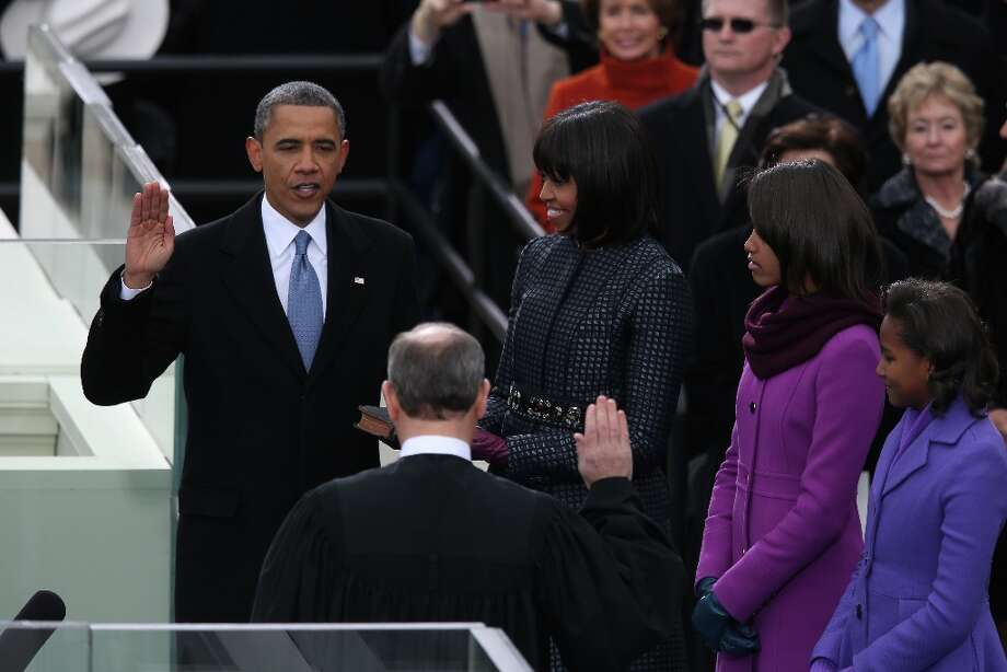 U.S. President Barack Obama is sworn in by Supreme Court Chief Justice John Roberts as First lady Michelle Obama and daughters, Sasha Obama and Malia Obama look on during the public ceremonial inauguration on the West Front of the U.S. Capitol January 21, 2013 in Washington, DC.  Barack Obama was re-elected for a second term as President of the United States. Photo: Mark Wilson, Getty Images / 2013 Getty Images