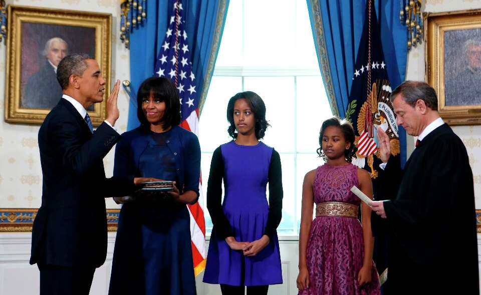 President Barack Obama is officially sworn-in by Chief Justice John Roberts in the Blue Room of the