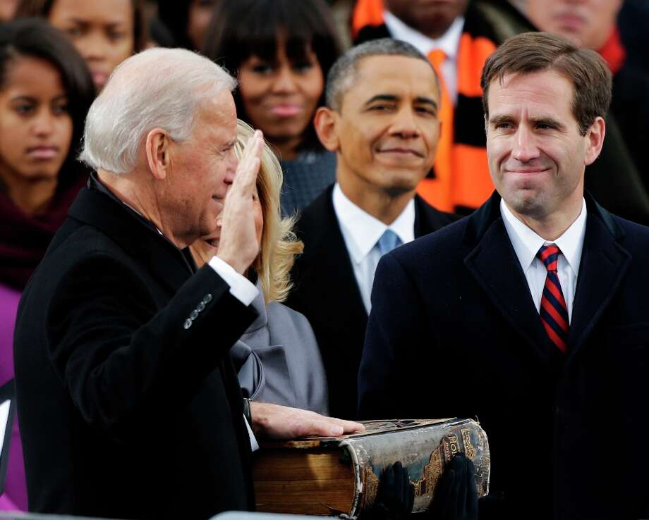 President Barack Obama, center and Beau Biden, Attorney of Deleware, right, watch as his father Joe Biden is sworn in at the ceremonial swearing-in at the U.S. Capitol during the 57th Presidential Inauguration in Washington, Monday, Jan. 21, 2013. Photo: Pablo Martinez Monsivais, Associated Press / AP