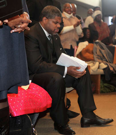 Rev. Tyrone P. Jones, IV listens to a song before speaking at  Bridgeport Black Pride's Dr. Martin Luther King Jr. celebration at Mt. Aery Baptist Church in Bridgeport, Conn. on Monday, January 21, 2013. Photo: BK Angeletti, B.K. Angeletti / Connecticut Post freelance B.K. Angeletti