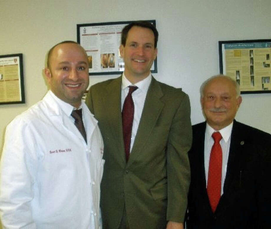 Scott Weiss, D.P.M., left, and his father, Robert F. Weiss, D.P.M., of the Foot & Ankle Institute in Darien recently hosted a visit by U.S. Rep. Jim Himes, D-4, center. Photo: Contributed