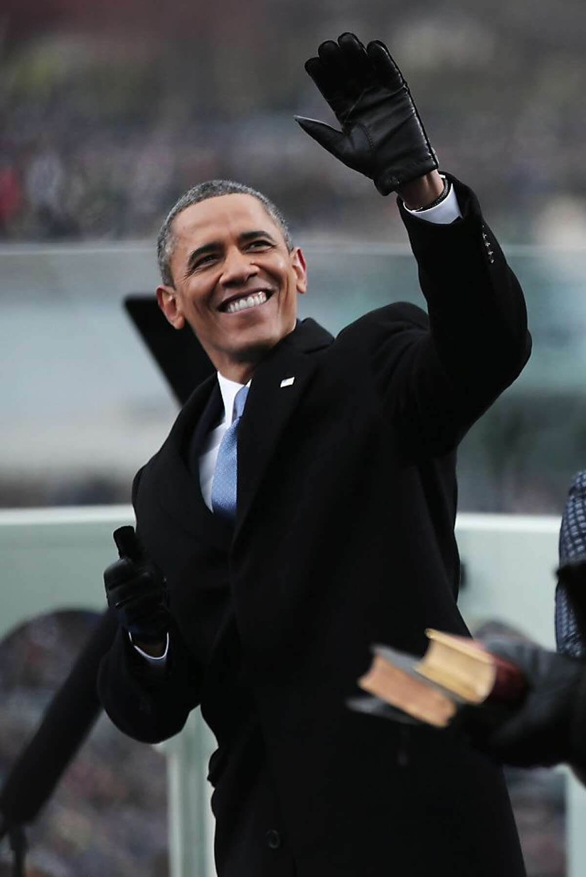 US President Barack Obama waves during the presidential inauguration on the West Front of the US Capitol January 21, 2013 in Washington, DC. Barack Obama was re-elected for a second term as President of the United States. AFP PHOTO/POOL/WIN MCNAMEEWIN MCNAMEE/AFP/Getty Images