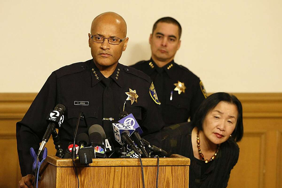 Oakland Police Chief, Howard Jordan, and Oakland Mayor, Jean Quan, strain to hear a question during at a press conference at City Hall on December 27, 2012 in Oakland.