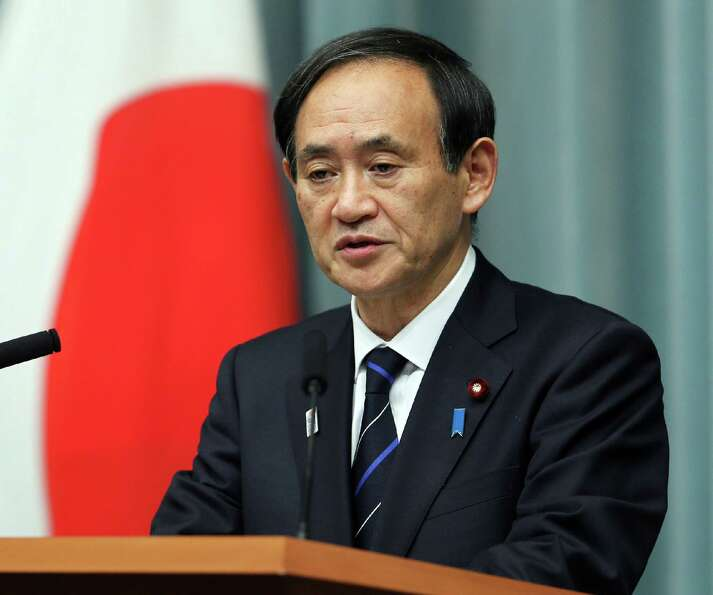 Japanese Chief Cabinet Secretary Yoshihide Suga speaks before press at the prime minister's official