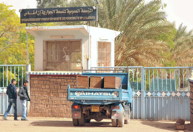 A truck loaded with empty coffins waits at the main entrance of the hospital where the bodies of persons killed during the hostage situation in a gas plant are gathered in Ain Amenas, Monday, Jan. 21, 2013. At least 81 people have been reported dead, including 32 Islamist militants, after a bloody, four-day hostage situation at Algeria's remote Ain Amenas natural gas plant. (AP Photo/Anis Belghoul) Photo: Anis Belghoul, Associated Press / AP