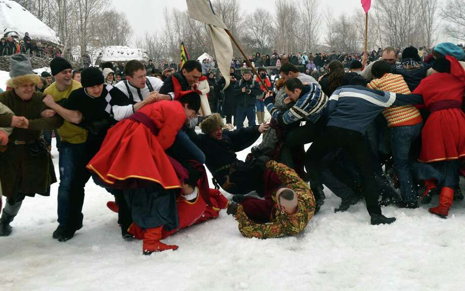 Ukrainian Cossacks partake in traditional fights on Friday during Orthodox Epiphany celebration in Kiev. (SERGEI SUPINSKY/AFP/Getty Images) Photo: SERGEI SUPINSKY, Multiple / 2013 AFP