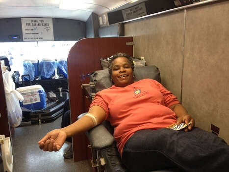 Lorraine Townes gives blood after the MLK march. For the last six years, the South Texas Blood and Tissue Center has set up a mobile blood drive near the concert stage at the end of the MLK march in Pittman-Sullivan Park. Photo: Sarah Tressler/Express-News