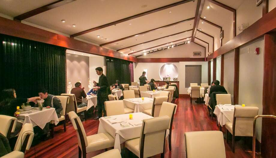 The restaurant has a modern feel, with high ceilings, white leather chairs and an entrance that looks more like a concierge desk than a host stand.