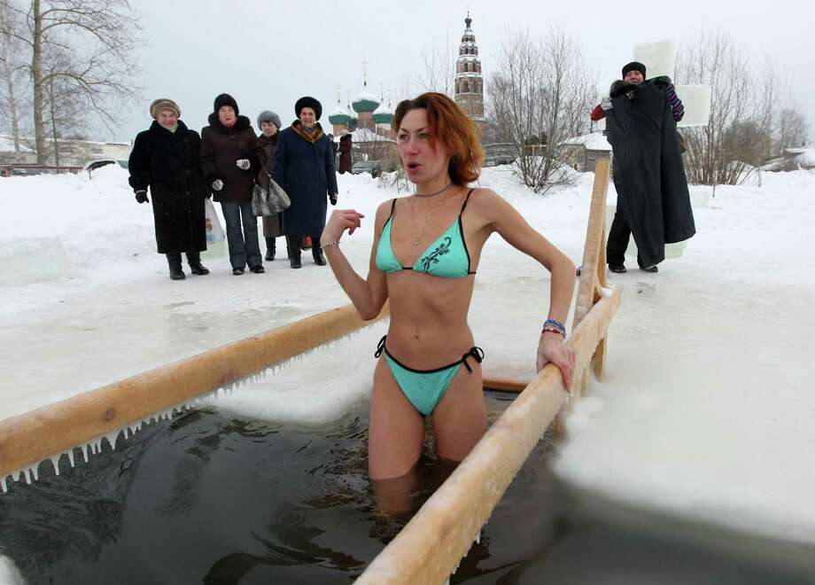 YAROSAVL, RUSSIA - JANUARY 19: A Russian Orthodox bathes in the icy-cold water of a lake during Orthodox Epiphany celebrations on January 19, 2013 in the Yaroslavl region, 260 km north of Moscow, Russia.  People all over Russia are taking part in a baptism ceremony, one the biggest events in the Christian Orthodox calendar. (Photo by Sasha Mordovets/Getty Images) Photo: Sasha Mordovets, Multiple / 2013 Sasha Mordovets