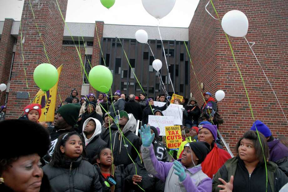 Children release balloons in memory of the people who died at Sandy Hook School at Martin Luther King Jr. rally at Bethel A.M.E. Church and before march in Stamford, Conn. on Monday January 21, 2013. Photo: Dru Nadler / Stamford Advocate Freelance