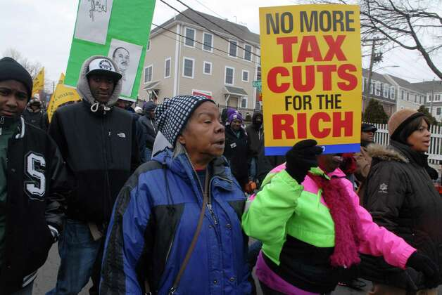 Martin Luther King Jr. Day marchers walk down Richmond Hill Ave in Stamford, Conn. on Monday January 21, 2013. Photo: Dru Nadler / Stamford Advocate Freelance
