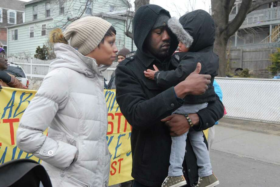 Porsche and Glen Brice and their son Landon (2) walk in the Martin Luther King Jr. Day march in Stamford, Conn. on Monday January 21, 2013. Photo: Dru Nadler / Stamford Advocate Freelance