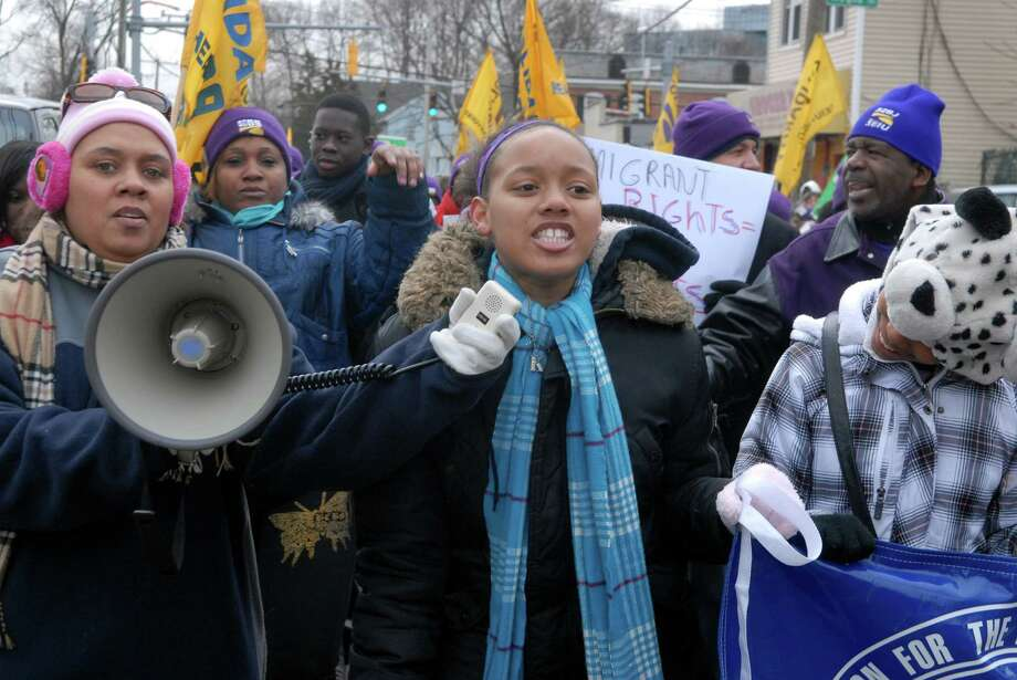 Crystal Collins and daughter Kasey (10) walk in the in the Martin Luther King Jr. Day march in Stamford, Conn. on Monday January 21, 2013. Photo: Dru Nadler / Stamford Advocate Freelance
