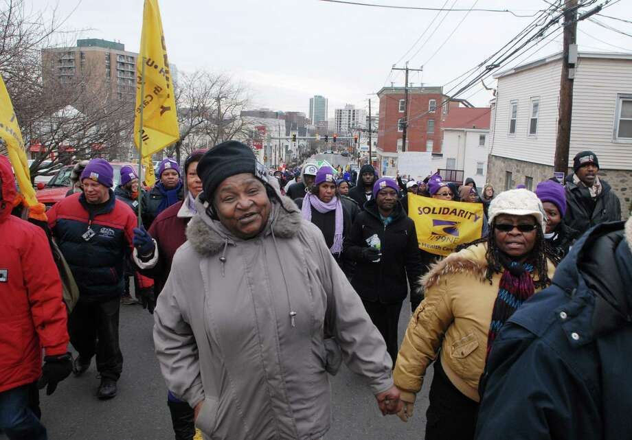 Participants in the Martin Luther King Jr. Day march walk up West Main St  in Stamford, Conn. on Monday January 21, 2013. Photo: Dru Nadler / Stamford Advocate Freelance
