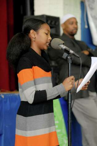 Mala Desai (10) from Westover School speaks at the celebration following the Martin Luther King Jr march at the Yerwood Center in Stamford, Conn. on Monday January 21, 2013. Photo: Dru Nadler / Stamford Advocate Freelance