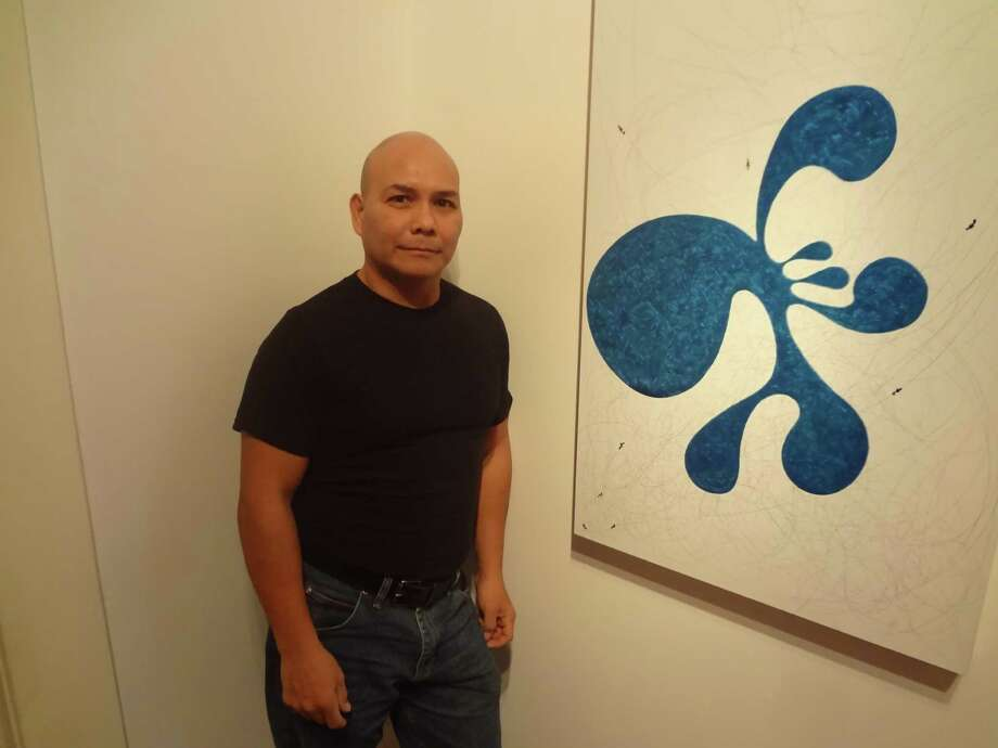 "San Antonio artist Estevan Arredondo creates his organic shapes for paintings such as ""flim flam o"" ""intuitively,"" he says, sometimes looking to the Aztec codex or Native American art for inspiration. Photo: Photo By Steve Bennett"